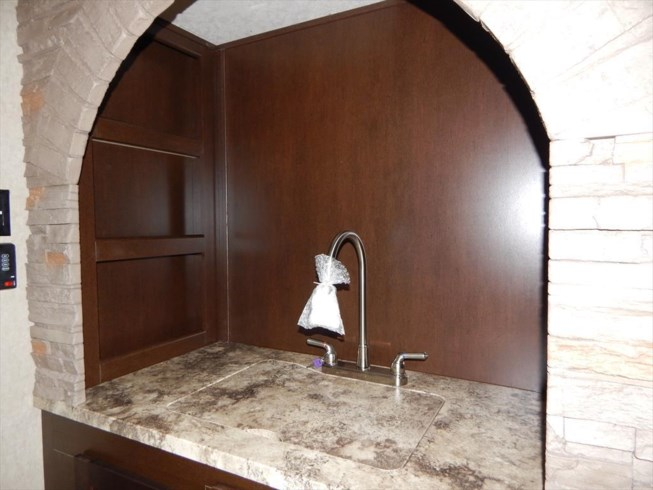 sink area with shelving