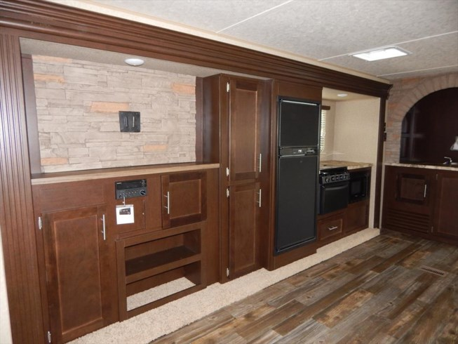 entertainment center and kitchen view