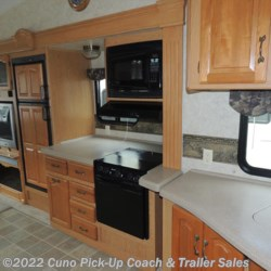 Kitchen w/ Microwave, Stove/Oven & Upper Cabinets