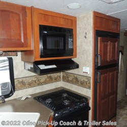 kitchen w/ microwave, double door refrigerator, stove/oven