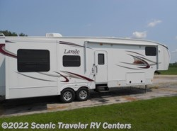 Used 2011  Keystone Laredo 310RE by Keystone from Scenic Traveler RV Centers in Slinger, WI