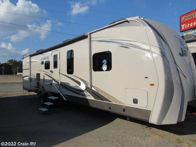 Excellent Heartland Trail Runner Camper 28BHK, 30 Ft Camper Has A Queen Bed In The Front With Under Bed Storage Entertainment Center, Couch Bed, Huge Table, Gas Stove, Microwave, Bunk Beds In The Back The Awing Is In Great Shape, Electric No