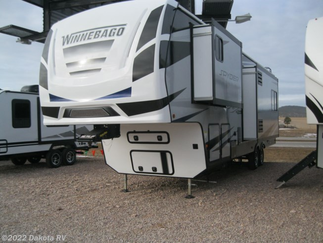 2020 Winnebago Spyder 29SFW - New Toy Hauler For Sale by Dakota RV in Rapid City, South Dakota features 50 Amp Service, Air Conditioning, Automatic Leveling Jacks, Azdel Composite Panels, Bluetooth Stereo, Booth Dinette, Cable Prepped, CD Player, CO Detector, Converter, Detachable Power Cord, Dinette Bed, DVD Player, Enclosed Underbelly, Enclosed Water Tank, Exterior Speakers, External Shower, Fiberglass Sidewalls, Fire Extinguisher, Fuel Cell w/ Pump Station, Furnace, Generator, Glass Shower Door, Heated Underbelly, Heated Water Tank, King Size Bed, Ladder, Leather Furniture, LED HDTV, LED Lights, Load Lights, LP Detector, Medicine Cabinet, Multi Media Sound System w/Input Jacks, Oven, Overhead Cabinetry, Pantry, Pass Thru Storage, Pleated Shades, Power Awning, Power Roof Vent, Powered Landing Legs, Propane, Queen Mattress, Rear Ramp Door, Refrigerator, Removable Table, Roof Vents, Screen Door, Self Contained, Skylight, Slideout, Smoke Detector, Sofa Bed, Solar Prep, Stove, Tinted Windows, TV Antenna, Water Heater