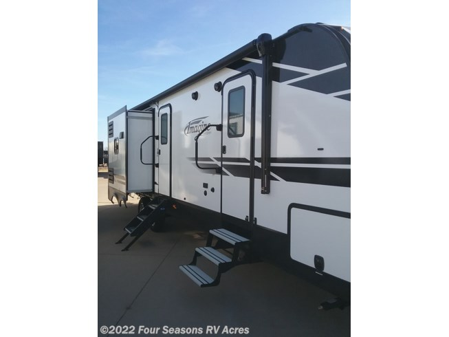 2020 Grand Design Imagine 3250BH - New Travel Trailer For Sale by Four Seasons RV Acres in Abilene, Kansas features 50 Amp Service, Air Conditioning, Auxiliary Battery, Booth Dinette, Bunk Beds, CD Player, CO Detector, DVD Player, Exterior Grill, Exterior Speakers, External Shower, Fireplace, Furnace, Ladder, Leveling Jacks, LP Detector, Medicine Cabinet, Microwave, Outside Kitchen, Oven, Power Awning, Power Roof Vent, Queen Bed, Refrigerator, Roof Vents, Shower, Skylight, Slideout, Smoke Detector, Solar Panels, Solar Prep, Spare Tire Kit, Stove Top Burner, Theater Seating, Toilet, TV, Water Heater