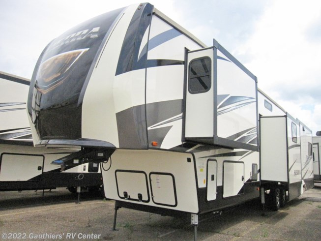 2019 Forest River Sierra 372LOK - New Fifth Wheel For Sale by Gauthiers' RV Center in Scott, Louisiana features Air Conditioning, Auxiliary Battery, Awning, Booth Dinette, Bunk Beds, CD Player, Ceiling Fan, CO Detector, DVD Player, Exterior Grill, Exterior Speakers, External Shower, Fireplace, Ladder, Leveling Jacks, LP Detector, Medicine Cabinet, Microwave, Outside Kitchen, Oven, Queen Bed, Refrigerator, Rocker Recliner(s), Roof Vents, Shower, Skylight, Slideout, Smoke Detector, Spare Tire Kit, Stove Top Burner, Surround Sound System, Toilet, TV, Water Heater
