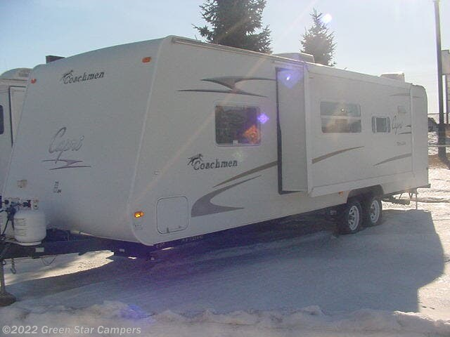 2006 Coachmen Capri 300 QBS - Used Travel Trailer For Sale by Green Star Campers in Rapid City, South Dakota features Air Conditioning, Awning, Bunk Beds, Furnace, Microwave, Power Hitch Jack, Queen Bed, Refrigerator, Spare Tire Kit, Stabilizer Jacks, Stereo System, Stove Top Burner, TV Antenna, Water Heater