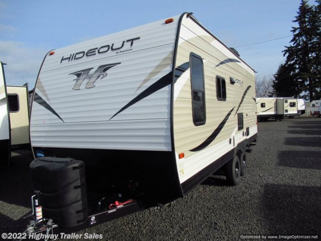 2019 Keystone Hideout 19LHSWE - New Travel Trailer For Sale by Highway Trailer Sales in Salem, Oregon features 30 Amp Service, Air Conditioning, AM/FM/CD, Auxiliary Battery, Black Tank Flush, Booth Dinette, Bunk Beds, Bunkhouse, CD Player, CO Detector, Dinette Bed, DVD Player, Exterior Speakers, External Shower, Furnace, Kitchen Sink, Ladder, LED Lights, LP Detector, Medicine Cabinet, Microwave, Oven, Overhead Cabinetry, Pass Thru Storage, Power Awning, Propane, Refrigerator, Roof Vents, Screen Door, Sewer Hose & Carrier, Shower, Smoke Detector, Sofa Bed, Solar Prep, Spare Tire Kit, Stabilizer Jacks, Stove Top Burner, Surround Sound System, Tinted Windows, Toilet, TV, Wardrobe(s), Water Heater