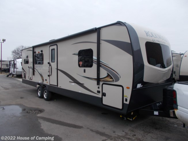 2019 Forest River Rockwood Ultra Lite 2902WS - New Travel Trailer For Sale by House of Camping in Bridgeview, Illinois features 50 Amp Service, Air Conditioning, Alloy Wheels, AM/FM/CD, Auxiliary Battery, Battery Charger, Black Tank Flush, Bluetooth Stereo, Booth Dinette, Cable Prepped, CD Player, CO Detector, Converter, Corian Countertops, Create-a-Breeze Fan, Day/Night Shades, Dinette, Dinette Bed, DVD Player, Enclosed Underbelly, Enclosed Water Tank, Exterior Grill, Exterior Refrigerator, Exterior Speakers, External Shower, Fiberglass Sidewalls, Fire Extinguisher, Fireplace, Front Overhead Storage, Furnace, Glass Shower Door, Heated Underbelly, Heated Water Tank, Hide-A-Bed, Kitchen Sink, Ladder, LED HDTV, LED Lights, LP Detector, Medicine Cabinet, Microwave, Oven, Overhead Cabinetry, Pantry, Pass Thru Storage, Pleated Shades, Power Awning, Power Hitch Jack, Power Roof Vent, Power Stabilizer Jacks, Propane, Queen Bed, Queen Mattress, Raised Refrigerator Panels, Refrigerator, Roof Vents, Satellite Prepped, Screen Door, Self Contained, Shower, Skylight, Slam Latch Baggage Doors, Slideout, Slide-out Awning, Smoke Detector, Solar Prep, Solid Surface Countertops, Spare Tire Kit, Stereo System, Stove, Stove Top Burner, Tinted Windows, Toilet, TV, TV Antenna, Vanity, Wardrobe(s), Water Heater
