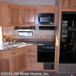 HW Motor Homes, Inc. 2009 Kingston 34QB **  Fifth Wheel by CrossRoads | Canton, Michigan