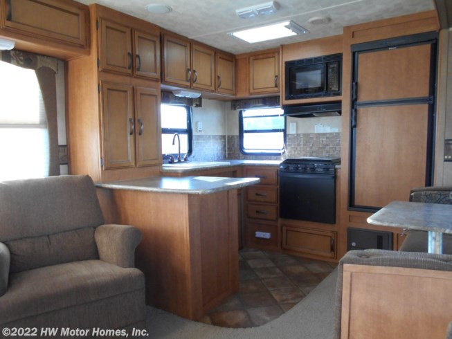 2014 Palomino Puma 30-RKSS - Used Travel Trailer For Sale by HW Motor Homes, Inc. in Canton, Michigan features 30 Amp Service, Air Conditioning, AM/FM/CD, Auxiliary Battery, Awning, Battery Charger, Bench Seat, Booth Dinette, Cable Prepped, CD Player, CO Detector, Comfort Fan, Converter, Detachable Power Cord, Dinette, Dinette Bed, DVD Player, Enclosed Underbelly, Enclosed Water Tank, Exterior Speakers, External Shower, Fire Extinguisher, Furnace, Kitchen Sink, LED Lights, Leveling Jacks, Living Quarters, LP Detector, Medicine Cabinet, Microwave, Mini Blinds, Oven, Overhead Cabinetry, Pet Friendly, Pleated Shades, Power Awning, Power Roof Vent, Propane, Queen Bed, Queen Mattress, Refrigerator, Rocker Recliner(s), Roof Vents, Screen Door, Self Contained, Sewer Hose & Carrier, Shower, Skylight, Slideout, Smoke Detector, Sofa Bed, Spare Tire Kit, Stabilizer Jacks, Stereo System, Stove, Stove Top Burner, Toilet, TV, TV Antenna, Wardrobe(s), Water Heater