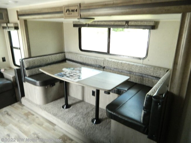 2020 Palomino Puma XLE Lite 25RLC - New Travel Trailer For Sale by HW Motor Homes, Inc. in Canton, Michigan features Air Conditioning, Auxiliary Battery, Awning, CD Player, CO Detector, DVD Player, Exterior Speakers, External Shower, Leveling Jacks, LP Detector, Medicine Cabinet, Microwave, Oven, Queen Bed, Refrigerator, Roof Vents, Shower, Skylight, Slideout, Smoke Detector, Spare Tire Kit, Stove Top Burner, Toilet, U-Shaped Dinette, Water Heater