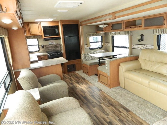 2016 Palomino Puma 30 RKSS - Used Travel Trailer For Sale by HW Motor Homes, Inc. in Canton, Michigan features 30 Amp Service, Air Conditioning, AM/FM/CD, Auxiliary Battery, Awning, Battery Charger, Bench Seat, Bluetooth Stereo, Cable Prepped, CO Detector, Comfort Fan, Converter, Detachable Power Cord, Enclosed Water Tank, External Shower, Fire Extinguisher, Front Overhead Storage, Furnace, Glass Shower Door, Kitchen Sink, Ladder, LED Lights, Living Quarters, Medicine Cabinet, Microwave, Oven, Overhead Cabinetry, Pleated Shades, Power Awning, Power Roof Vent, Propane, Queen Bed, Queen Mattress, Refrigerator, Screen Door, Self Contained, Sewer Hose & Carrier, Shower, Slideout, Smoke Detector, Sofa Bed, Spare Tire Kit, Stabilizer Jacks, Stove, Toilet, TV, TV Antenna, Wardrobe(s), Water Heater