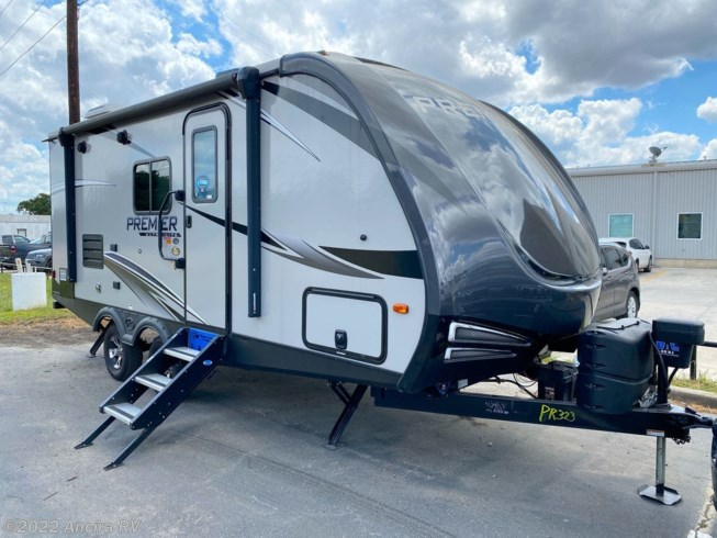 2019 Keystone Premier 19FBPR - Used Travel Trailer For Sale by Ancira RV in Boerne, Texas features Air Conditioning, Auxiliary Battery, Awning, CD Player, CO Detector, DVD Player, Exterior Speakers, External Shower, Leveling Jacks, LP Detector, Medicine Cabinet, Microwave, Oven, Queen Bed, Refrigerator, Roof Vents, Shower, Skylight, Slideout, Smoke Detector, Spare Tire Kit, Stove Top Burner, Toilet, TV, U-Shaped Dinette, Water Heater