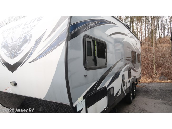 2015 Forest River XLR Hyperlite 24HFS - Used Toy Hauler For Sale by Ansley RV in Duncansville, Pennsylvania features Air Conditioning, AM/FM/CD, Auxiliary Battery, Awning, Batteries, Battery Charger, CD Player, CO Detector, DVD Player, External Shower, Furnace, Leveling Jacks, LP Detector, Medicine Cabinet, Microwave, Non-Smoking Unit, Queen Bed, Refrigerator, Roof Vents, Self Contained, Shower, Skylight, Smoke Detector, Spare Tire Kit, Stove Top Burner, Toilet, Water Heater