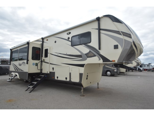 2020 Grand Design Solitude S-CLASS 3740BH - Used Fifth Wheel For Sale by McClain's RV Oklahoma City in Oklahoma City, Oklahoma features 50 Amp Service, Air Conditioning, Alloy Wheels, Aluminum Entrance Steps, Automatic Leveling Jacks, Auxiliary Battery, Awning, Bath & 1/2, Black Tank Flush, Bluetooth Stereo, Bunkhouse, Cable Prepped, CO Detector, Convection Microwave, Converter, Detachable Power Cord, Enclosed Underbelly, Enclosed Water Tank, Exterior Grill, Exterior Refrigerator, Exterior Speakers, External Shower, Fire Extinguisher, Fireplace, Furnace, Glass Shower Door, Heated Underbelly, Island Kitchen, Kitchen Sink, Ladder, Leather Furniture, LED HDTV, LED Lights, Leveling Jacks, Living Quarters, Load Lights, LP Detector, Medicine Cabinet, Non-Smoking Unit, Outside Kitchen, Oven, Overhead Cabinetry, Pantry, Pass Thru Storage, Power Roof Vent, Power Stabilizer Jacks, Powered Landing Legs, Propane, Queen Bed, Recliner(s), Refrigerator, Satellite Prepped, Screen Door, Shower, Skylight, Slam Latch Baggage Doors, Slideout, Smoke Detector, Solar Prep, Solid Surface Countertops, Spare Tire Kit, Stainless Appliances, Stove, Stove Cover, Stove Top Burner, Theater Seating, Toilet, TV, TV Antenna, Washer/Dryer Prep, Water Heater