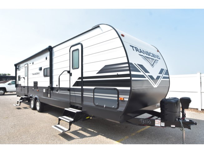 2021 Grand Design Transcend 32BHS - New Travel Trailer For Sale by McClain's RV Oklahoma City in Oklahoma City, Oklahoma features 30 Amp Service, 50/50 Rear Door, Air Conditioning, Alloy Wheels, Aluminum Entrance Steps, Auxiliary Battery, Black Tank Flush, Bluetooth Stereo, Booth Dinette, Bunk Beds, Bunkhouse, Cable Prepped, CO Detector, Detachable Power Cord, Dinette Bed, Electric Jack, Enclosed Underbelly, Enclosed Water Tank, Exterior Grill, Exterior Refrigerator, Exterior Speakers, External Shower, Fire Extinguisher, Furnace, Heated Underbelly, Heated Water Tank, Hitch, Kitchen Sink, Ladder, Leather Furniture, LED HDTV, LED Lights, Leveling Jacks, Living Quarters, Load Lights, LP Detector, Medicine Cabinet, Microwave, Outside Kitchen, Oven, Overhead Cabinetry, Pass Thru Storage, Pleated Shades, Power Awning, Power Roof Vent, Power Stabilizer Jacks, Propane, Recliner(s), Refrigerator, Roof Vent, Roof Vents, Satellite Prepped, Screen Door, Shower, Skylight, Slam Latch Baggage Doors, Slideout, Smoke Detector, Solar Prep, Solid Surface Countertops, Spare Tire Kit, Stabilizer Jacks, Stove, Stove Cover, Stove Top Burner, Theater Seating, Thermal Pane Windows, Tinted Windows, Toilet, TV Antenna, Water Heater