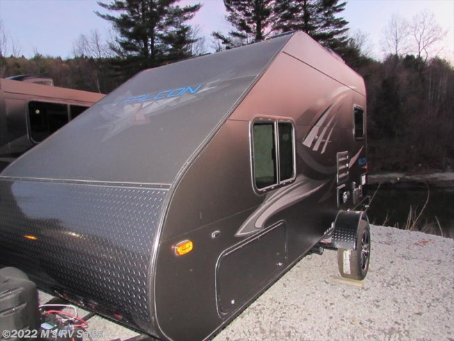 2018 Travel Lite **FALCON**  F-20 - Used Travel Trailer For Sale by M's RV Sales in Berlin, Vermont features Air Conditioning, Auxiliary Battery, Awning, CD Player, CO Detector, Converter, DVD Player, Exterior Speakers, External Shower, Furnace, LP Detector, Microwave, Queen Bed, Refrigerator, Self Contained, Skylight, Smoke Detector, Spare Tire Kit, Stove Top Burner, TV, TV Antenna, Water Heater