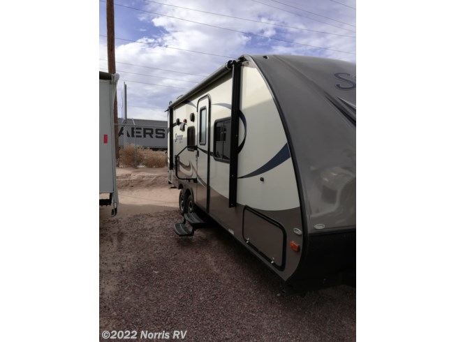 2017 Forest River Surveyor 220RBS - Used Travel Trailer For Sale by Norris RV in Casa Grande, Arizona features Air Conditioning, Auxiliary Battery, Awning, CD Player, CO Detector, DVD Player, External Shower, LP Detector, Medicine Cabinet, Microwave, Oven, Queen Bed, Refrigerator, Roof Vents, Shower, Skylight, Slideout, Smoke Detector, Spare Tire Kit, Stove Top Burner, Surround Sound System, Toilet, TV, Water Heater