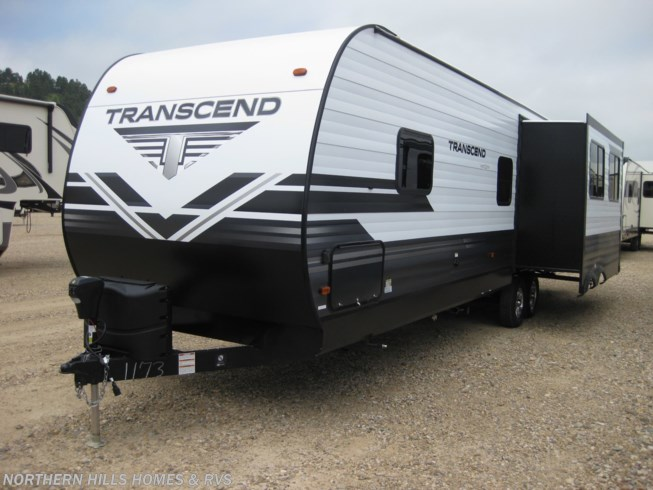 2019 Grand Design Transcend 28MKS - New Travel Trailer For Sale by Northern Hills Homes and RV's in Whitewood, South Dakota features 50 Amp Service, Air Conditioning, Alloy Wheels, AM/FM/CD, Auxiliary Battery, Black Tank Flush, Bluetooth Stereo, Booth Dinette, Cable Prepped, CO Detector, Detachable Power Cord, Dinette, DVD Player, Enclosed Underbelly, Enclosed Water Tank, Exterior Speakers, External Shower, Fire Extinguisher, Furnace, Heated Underbelly, Ladder, LED HDTV, LED Lights, LP Detector, Medicine Cabinet, Microwave, Outside Kitchen, Oven, Overhead Cabinetry, Power Awning, Power Hitch Jack, Power Roof Vent, Propane, Queen Bed, Refrigerator, Rocker Recliner(s), Roof Vents, Satellite Radio, Sewer Hose & Carrier, Shower, Skylight, Slideout, Smoke Detector, Sofa Bed, Solar Prep, Spare Tire Kit, Stabilizer Jacks, Stove, Stove Top Burner, Theater Seating, Toilet, TV Antenna, Water Heater