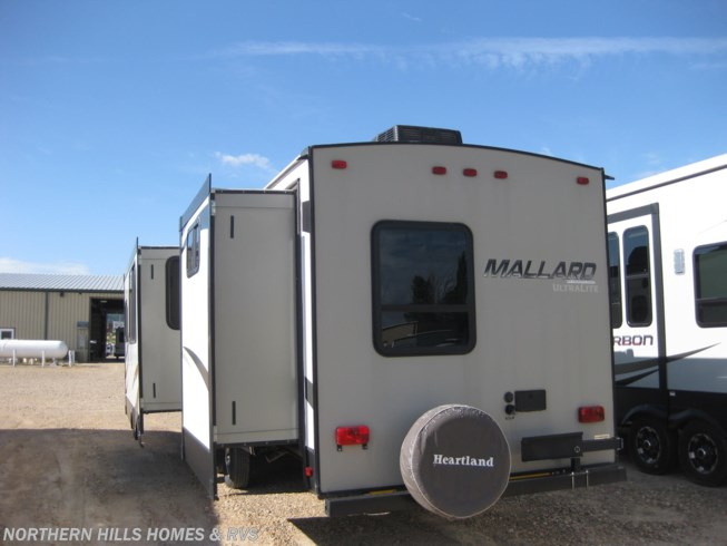 2016 Heartland Mallard M33 - Used Travel Trailer For Sale by Northern Hills Homes and RV's in Whitewood, South Dakota features Air Conditioning, Auxiliary Battery, Awning, Bunk Beds, CD Player, Central Vacuum, CO Detector, DVD Player, Exterior Grill, Exterior Speakers, Leveling Jacks, LP Detector, Medicine Cabinet, Microwave, Outside Kitchen, Oven, Power Roof Vent, Queen Bed, Refrigerator, Roof Vents, Shower, Skylight, Slideout, Smoke Detector, Spare Tire Kit, Stove Top Burner, Toilet, U-Shaped Dinette, Water Heater