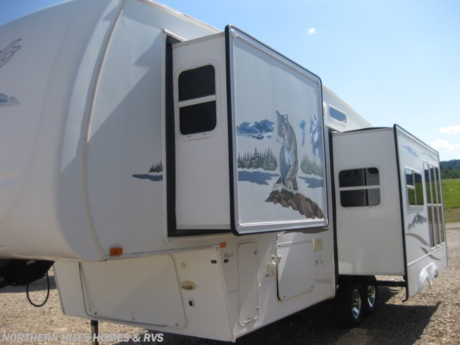 2008 Forest River Wildcat 28RKBS East Coast - Used Fifth Wheel For Sale by Northern Hills Homes and RV's in Whitewood, South Dakota features Air Conditioning, Auxiliary Battery, Awning, Booth Dinette, CD Player, CO Detector, DVD Player, Exterior Speakers, Ladder, Leveling Jacks, LP Detector, Medicine Cabinet, Microwave, Outside Entertainment Center, Queen Bed, Refrigerator, Roof Vents, Shower, Skylight, Slideout, Smoke Detector, Spare Tire Kit, Toilet, TV, Water Heater