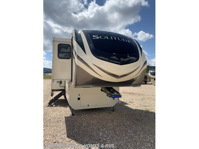 2021 Grand Design Solitude 380FL - New Fifth Wheel For Sale by Northern Hills Homes and RV's in Whitewood, South Dakota features 50 Amp Service, Air Conditioning, Alloy Wheels, Automatic Leveling Jacks, Auxiliary Battery, Awning, Black Tank Flush, Bluetooth Stereo, CD Player, Central Vacuum, CO Detector, DVD Player, Enclosed Underbelly, Exterior Speakers, Fireplace, Free Standing Dinette w/Chairs, Heat Pump, Heated Underbelly, King Size Bed, Ladder, LP Detector, Medicine Cabinet, Microwave, Mor-Ryde Pin Box, Oven, Pass Thru Storage, Power Roof Vent, Refrigerator, Rocker Recliner(s), Roof Vents, Satellite Radio, Second Roof A/C, Shower, Skylight, Slam Latch Baggage Doors, Slideout, Smoke Detector, Solid Surface Countertops, Spare Tire Kit, Stainless Appliances, Stove Top Burner, Table and Chairs, Theater Seating, Thermal Pane Windows, Tinted Windows, Toilet, TV, Washer/Dryer Prep, Water Heater
