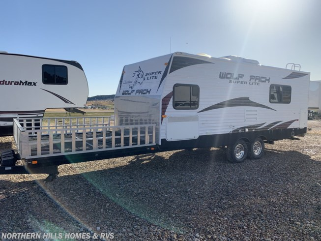 2010 Cherokee Wolf Pack 23DFWP - New Toy Hauler For Sale by Northern Hills Homes and RV's in Whitewood, South Dakota features 30 Amp Service, Water Heater, Awning, Refrigerator, Air Conditioning
