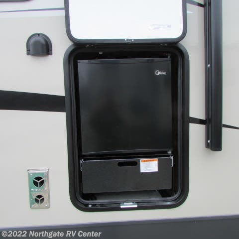 2019 Forest River Flagstaff Super Lite 29RKWS - New Travel Trailer For Sale by Northgate RV Center in Louisville, Tennessee features 50 Amp Service, Air Conditioning, Auxiliary Battery, Batteries, Booth Dinette, CD Player, CO Detector, DVD Player, Exterior Grill, Exterior Speakers, External Shower, Fireplace, Furnace, Leveling Jacks, LP Detector, Medicine Cabinet, Microwave, Outside Kitchen, Oven, Power Awning, Power Roof Vent, Queen Bed, Queen Mattress, Refrigerator, Roof Vents, Shower, Skylight, Slideout, Slide-out Awning, Smoke Detector, Solar Prep, Spare Tire Kit, Stove Top Burner, Surround Sound System, Toilet, TV, Water Heater
