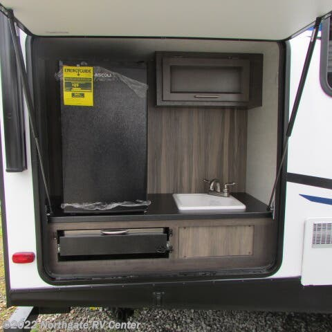 2020 CrossRoads Sunset Trail Super Lite 253RB - New Travel Trailer For Sale by Northgate RV Center in Louisville, Tennessee features 30 Amp Service, Air Conditioning, Alloy Wheels, AM/FM/CD, Auxiliary Battery, Batteries, Black Tank Flush, Bluetooth Stereo, Booth Dinette, CD Player, CO Detector, Converter, Detachable Power Cord, DVD Player, Electric Jack, Exterior Speakers, External Shower, Furnace, King Size Bed, Kitchen Sink, Ladder, LED Lights, LP Detector, Medicine Cabinet, Microwave, Outside Kitchen, Oven, Power Awning, Power Stabilizer Jacks, Propane, Refrigerator, Roof Vents, Satellite Prepped, Screen Door, Sewer Hose & Carrier, Shower, Skylight, Slideout, Smoke Detector, Solar Prep, Solid Surface Countertops, Spare Tire Kit, Stabilizer Jacks, Stainless Appliances, Stove, Theater Seating, Tinted Windows, Toilet, TV, TV Antenna, Wardrobe(s), Water Heater