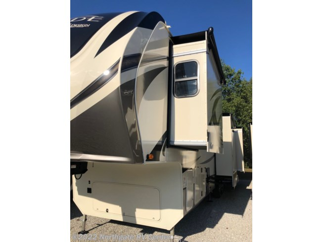 2020 Grand Design Solitude 3950BH-R - New Fifth Wheel For Sale by Northgate RV Center in Ringgold, Georgia features 50 Amp Service, Air Conditioning, Alloy Wheels, Automatic Leveling Jacks, Auxiliary Battery, Batteries, Black Tank Flush, Bluetooth Stereo, Bunk Beds, Cable Prepped, CO Detector, Convection Microwave, Converter, Detachable Power Cord, Enclosed Underbelly, Exterior Speakers, External Shower, Fireplace, Free Standing Dinette w/Chairs, Furnace, Glass Shower Door, Heat Pump, Heated Underbelly, Island Kitchen, King Size Bed, Kitchen Sink, Ladder, LED Lights, LP Detector, Medicine Cabinet, Oven, Overhead Cabinetry, Power Awning, Propane, Residential Refrigerator, Roof Vents, Satellite Prepped, Screen Door, Second Roof A/C, Sewer Hose & Carrier, Shower, Skylight, Slam Latch Baggage Doors, Slideout, Slide-out Awning, Smoke Detector, Solid Surface Countertops, Spare Tire Kit, Stainless Appliances, Stove, Table and Chairs, Tinted Windows, Toilet, TV, TV Antenna, Wardrobe(s), Washer/Dryer Prep, Water Heater