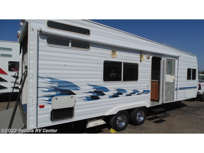 2004 Weekend Warrior 2600FS - Used Toy Hauler For Sale by Pedata RV Center in Tucson, Arizona features Air Conditioning, AM/FM/CD, Awning, Batteries, Battery Charger, CO Detector, Converter, External Shower, Fire Extinguisher, Furnace, Generator, Ladder, LP Detector, Microwave, Mini Blinds, Non-Smoking Unit, Oven, Power Hitch Jack, Propane, Refrigerator, Roof Vent, Screen Door, Smoke Detector, Stabilizer Jacks, Tinted Windows, Water Heater