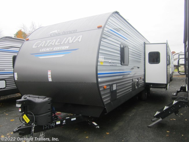 2019 Coachmen Catalina 293RLDS - New Travel Trailer For Sale by Orchard Trailers, Inc. in Whately, Massachusetts features Air Conditioning, Auxiliary Battery, Awning, Booth Dinette, CD Player, CO Detector, DVD Player, Exterior Grill, Exterior Speakers, External Shower, Leveling Jacks, LP Detector, Medicine Cabinet, Microwave, Outside Kitchen, Oven, Queen Bed, Refrigerator, Rocker Recliner(s), Roof Vents, Shower, Skylight, Slideout, Smoke Detector, Spare Tire Kit, Stove Top Burner, Toilet, TV, Water Heater