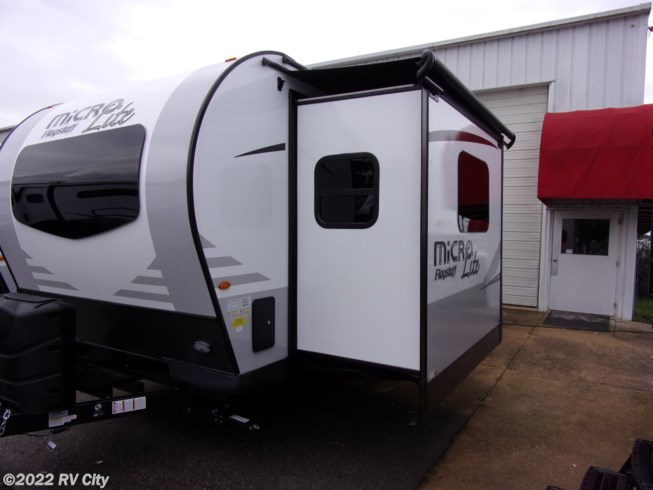 2019 Forest River Flagstaff Micro Lite 25FKS - New Travel Trailer For Sale by RV City in Benton, Arkansas features 30 Amp Service, Air Conditioning, Alloy Wheels, AM/FM/CD, Battery Charger, Black Tank Flush, Bluetooth Stereo, CO Detector, Day/Night Shades, DVD Player, Electric Jack, Enclosed Underbelly, Enclosed Water Tank, Exterior Grill, Furnace, Glass Shower Door, Heated Mattress, Heated Water Tank, Leveling Jacks, Medicine Cabinet, Microwave, Outside Kitchen, Oven, Overhead Cabinetry, Power Awning, Queen Bed, Queen Mattress, Raised Refrigerator Panels, Refrigerator, Roof Vent, Roof Vents, Self Contained, Shower, Solar Prep, Solid Surface Countertops, Stereo System, Stove Top Burner, Toilet, TV, U-Shaped Dinette, Water Heater