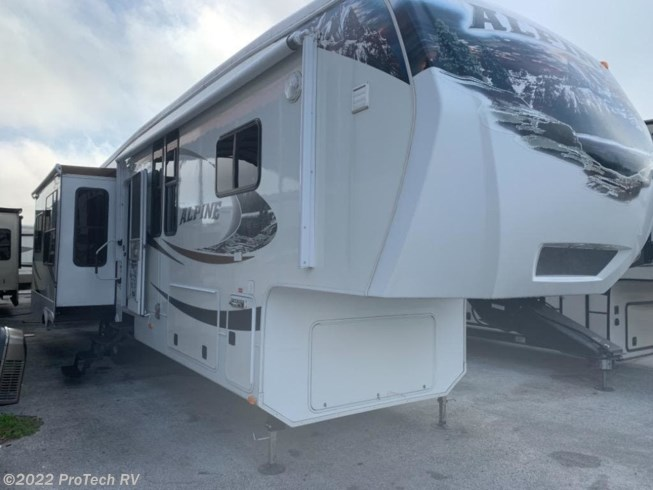 2012 Keystone Alpine 3450RL - Used Fifth Wheel For Sale by ProTech RV in Clermont, Florida features Air Conditioning, Auxiliary Battery, Awning, CD Player, Ceiling Fan, CO Detector, Converter, DVD Player, External Shower, Fantastic Fan, Free Standing Dinette w/Chairs, Inverter, King Size Bed, Ladder, Leveling Jacks, LP Detector, Medicine Cabinet, Microwave, Non-Smoking Unit, Oven, Power Roof Vent, Queen Bed, Refrigerator, Rocker Recliner(s), Roof Vents, Shower, Skylight, Slideout, Smoke Detector, Spare Tire Kit, Stove Top Burner, Surround Sound System, Toilet, TV, TV Antenna, Water Heater