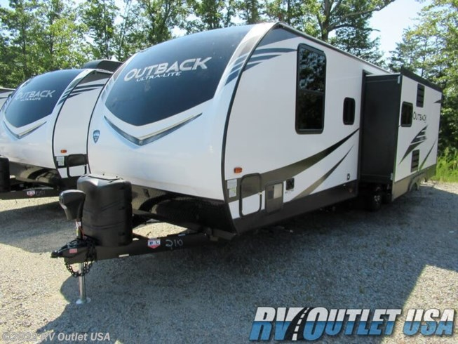 2020 Keystone Outback Ultra-Lite 280URB - New Travel Trailer For Sale by RV Outlet USA in Ringgold, Virginia features 50 Amp Service, Air Conditioning, Alloy Wheels, Aluminum Entrance Steps, AM/FM/CD, Auxiliary Battery, Battery Charger, Black Tank Flush, Cable Prepped, CO Detector, Converter, Detachable Power Cord, DVD Player, Enclosed Underbelly, Enclosed Water Tank, Exterior Speakers, External Shower, Fire Extinguisher, Free Standing Dinette w/Chairs, Furnace, Glass Shower Door, Heated Underbelly, Heated Water Tank, Kitchen Sink, LED HDTV, LED Lights, LP Detector, Medicine Cabinet, Microwave, Outside Kitchen, Oven, Overhead Cabinetry, Pantry, Pass Thru Storage, Pleated Shades, Power Awning, Power Hitch Jack, Power Roof Vent, Propane, Queen Bed, Queen Mattress, Recliner(s), Refrigerator, Roof Vent, Roof Vents, Satellite Prepped, Screen Door, Shower, Skylight, Slideout, Smoke Detector, Solar Prep, Spare Tire Kit, Stabilizer Jacks, Stove Top Burner, Theater Seating, Tinted Windows, TV Antenna, Wardrobe(s), Water Heater