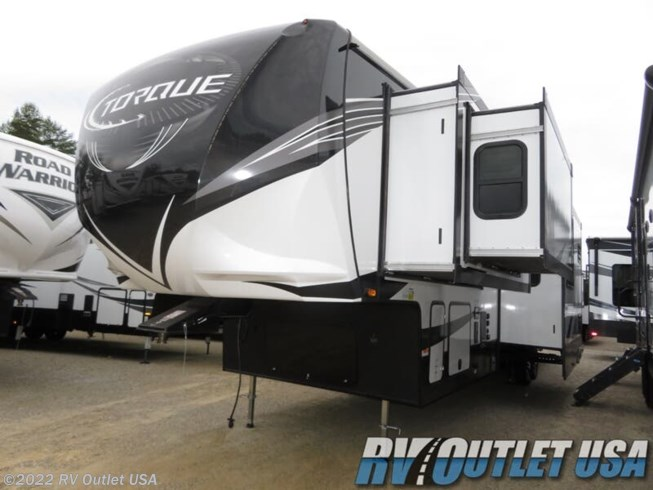 2020 Heartland Torque 373 - New Toy Hauler For Sale by RV Outlet USA in Ringgold, Virginia features 50 Amp Service, Air Conditioning, Alloy Wheels, Aluminum Entrance Steps, AM/FM/CD, Automatic Leveling Jacks, Auxiliary Battery, Bath & 1/2, Battery Charger, Black Tank Flush, Cable Prepped, CO Detector, Converter, Detachable Power Cord, Enclosed Underbelly, Enclosed Water Tank, Exterior Refrigerator, Exterior Speakers, External Shower, Fireplace, Fuel Cell w/ Pump Station, Furnace, Heated Underbelly, Heated Water Tank, Hide-A-Bed, King Size Bed, LED HDTV, LED Lights, Load Lights, LP Detector, Microwave, Outside Entertainment Center, Outside Kitchen, Oven, Overhead Cabinetry, Pantry, Pass Thru Storage, Pleated Shades, Power Awning, Powered Landing Legs, Propane, Rear Ramp Door, Recliner(s), Refrigerator, Roof Vent, Roof Vents, Screen Door, Second Roof A/C, Skylight, Slideout, Smoke Detector, Solar Prep, Solid Surface Countertops, Spare Tire Kit, Stainless Appliances, Stove, Theater Seating, Tinted Windows, TV, TV Antenna, Wardrobe(s), Washer/Dryer Prep, Water Heater
