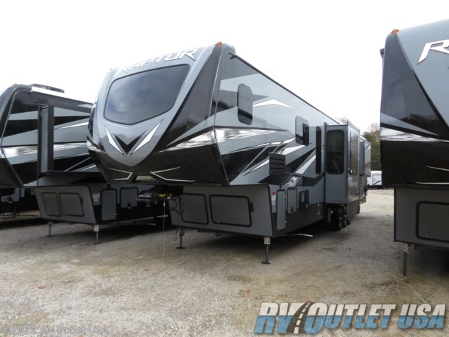 2020 Keystone Raptor 427 - New Toy Hauler For Sale by RV Outlet USA in Ringgold, Virginia features 50 Amp Service, Air Conditioning, Alloy Wheels, Aluminum Entrance Steps, AM/FM/CD, Automatic Leveling Jacks, Auxiliary Battery, Battery Charger, Black Tank Flush, Cable Prepped, Central Vacuum, CO Detector, Convection Microwave, Converter, Detachable Power Cord, Enclosed Underbelly, Enclosed Water Tank, Exterior Speakers, External Shower, Fire Extinguisher, Fireplace, Front Fiberglass Cap w/Window, Fuel Cell w/ Pump Station, Furnace, Generator, Glass Shower Door, Heated Underbelly, Heated Water Tank, Hide-A-Bed, King Size Bed, Ladder, LED HDTV, LED Lights, Load Lights, LP Detector, Medicine Cabinet, Mor-Ryde Suspension, Outside Entertainment Center, Oven, Overhead Cabinetry, Pantry, Pass Thru Storage, Pleated Shades, Power Awning, Power Lift, Power Roof Vent, Powered Landing Legs, Propane, Rear Ramp Door, Recliner(s), Refrigerator, Roof Vent, Roof Vents, Screen Door, Second Roof A/C, Self Contained, Shower, Skylight, Slideout, Smoke Detector, Solar Prep, Solid Surface Countertops, Sound Bar, Spare Tire Kit, Stainless Appliances, Stereo System, Stove Top Burner, Table and Chairs, Theater Seating, Tinted Windows, TV, TV Antenna, Upgraded Insulation Package, Wardrobe(s), Washer/Dryer Prep, Water Heater