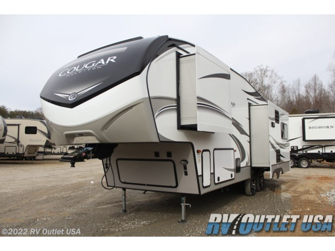 2020 Keystone Cougar 27SGS - New Fifth Wheel For Sale by RV Outlet USA in Ringgold, Virginia features Air Conditioning, Alloy Wheels, Aluminum Entrance Steps, Automatic Leveling Jacks, Auxiliary Battery, Battery Charger, Cable Prepped, CO Detector, Converter, Detachable Power Cord, DVD Player, Enclosed Underbelly, Enclosed Water Tank, Exterior Speakers, External Shower, Fireplace, Free Standing Dinette w/Chairs, Furnace, Heated Underbelly, Heated Water Tank, Hide-A-Bed, Hitch, Ladder, LED HDTV, LED Lights, Load Lights, LP Detector, Medicine Cabinet, Microwave, Oven, Overhead Cabinetry, Pass Thru Storage, Power Awning, Powered Landing Legs, Queen Bed, Queen Mattress, Recliner(s), Refrigerator, Roof Vent, Roof Vents, Screen Door, Shower, Skylight, Slideout, Smoke Detector, Solar Prep, Spare Tire Kit, Stove Top Burner, Tinted Windows, TV, TV Antenna, Wardrobe(s), Water Heater