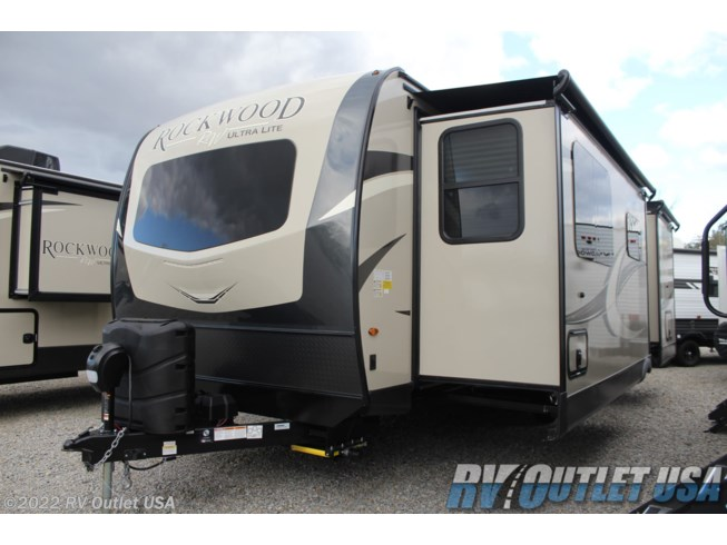 2020 Forest River Rockwood Ultra Lite 2608BS - New Travel Trailer For Sale by RV Outlet USA in Ringgold, Virginia features 50 Amp Service, Air Conditioning, Alloy Wheels, Aluminum Entrance Steps, Auxiliary Battery, Battery Charger, Black Tank Flush, Booth Dinette, Cable Prepped, CO Detector, Converter, Detachable Power Cord, Dinette Bed, Enclosed Underbelly, Enclosed Water Tank, Exterior Speakers, External Shower, Fiberglass Sidewalls, Fireplace, Furnace, Glass Shower Door, Heated Underbelly, Heated Water Tank, Ladder, LED HDTV, LED Lights, LP Detector, Medicine Cabinet, Microwave, Oven, Overhead Cabinetry, Pantry, Power Awning, Power Hitch Jack, Power Stabilizer Jacks, Propane, Queen Bed, Queen Mattress, Recliner(s), Refrigerator, Roof Vent, Roof Vents, Screen Door, Second Roof A/C, Shower, Slam Latch Baggage Doors, Slide-out Awning, Smoke Detector, Solar Prep, Solid Surface Countertops, Spare Tire Kit, Stereo System, Stove, Stove Cover, Theater Seating, Tinted Windows, Toilet, TV, TV Antenna, Wardrobe(s), Water Heater