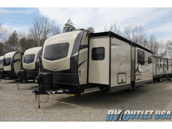 2021 Forest River Rockwood Ultra Lite 2911BS - New Travel Trailer For Sale by RV Outlet USA in Ringgold, Virginia features 50 Amp Service, Air Conditioning, Alloy Wheels, Aluminum Entrance Steps, Battery Charger, Black Tank Flush, Bunk Beds, Bunkhouse, Cable Prepped, CD Player, CO Detector, Converter, Detachable Power Cord, Dinette Bed, DVD Player, Electric Heat, Enclosed Underbelly, Enclosed Water Tank, Exterior Refrigerator, Exterior Speakers, External Shower, Fantastic Fan, Front Fiberglass Cap w/Window, Furnace, Heated Underbelly, Heated Water Tank, Hide-A-Bed, Kitchen Sink, Ladder, LED HDTV, LED Lights, LP Detector, Medicine Cabinet, Microwave, Outside Kitchen, Oven, Overhead Cabinetry, Pleated Shades, Power Awning, Power Hitch Jack, Power Stabilizer Jacks, Propane, Queen Bed, Queen Mattress, Raised Refrigerator Panels, Refrigerator, Roof Vent, Roof Vents, Screen Door, Second Roof A/C, Shower, Skylight, Slideout, Slide-out Awning, Solar Prep, Solid Surface Countertops, Sound Bar, Spare Tire Kit, Stove, Stove Cover, Tinted Windows, Toilet, TV, TV Antenna, U-Shaped Dinette, Wardrobe(s), Water Heater