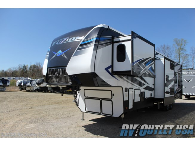 2020 Keystone Fuzion 373 - New Toy Hauler For Sale by RV Outlet USA in Ringgold, Virginia features 50 Amp Service, Air Conditioning, Alloy Wheels, AM/FM/CD, Automatic Leveling Jacks, Auxiliary Battery, Bath & 1/2, Battery Charger, Black Tank Flush, Cable Prepped, Ceiling Fan, Central Vacuum, CO Detector, Convection Microwave, Converter, Detachable Power Cord, DVD Player, Enclosed Underbelly, Enclosed Water Tank, Exterior Speakers, External Shower, Fire Extinguisher, Fireplace, Fuel Cell w/ Pump Station, Furnace, Generator, Glass Shower Door, Heated Underbelly, Heated Water Tank, Island Kitchen, King Size Bed, Ladder, LED HDTV, LED Lights, Load Lights, LP Detector, Medicine Cabinet, Mor-Ryde Pin Box, Mor-Ryde Suspension, Oven, Overhead Cabinetry, Pantry, Pass Thru Storage, Pleated Shades, Power Awning, Power Roof Vent, Powered Landing Legs, Propane, Rear Ramp Door, Recliner(s), Refrigerator, Roof Vent, Roof Vents, Screen Door, Second Roof A/C, Self Contained, Shower, Skylight, Slam Latch Baggage Doors, Slideout, Smoke Detector, Solar Prep, Solid Surface Countertops, Spare Tire Kit, Stainless Appliances, Stove Top Burner, Tinted Windows, TV, TV Antenna, Wardrobe(s), Washer/Dryer Prep, Water Heater
