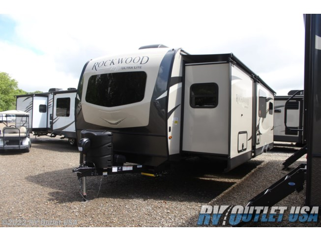 2021 Forest River Rockwood Ultra Lite 2614BS - New Travel Trailer For Sale by RV Outlet USA in Ringgold, Virginia features 50 Amp Service, Air Conditioning, Alloy Wheels, Aluminum Entrance Steps, AM/FM/CD, Auxiliary Battery, Battery Charger, Booth Dinette, Cable Prepped, CO Detector, Converter, Detachable Power Cord, Enclosed Underbelly, Enclosed Water Tank, Exterior Speakers, External Shower, Fantastic Fan, Fiberglass Sidewalls, Fire Extinguisher, Fireplace, Front Fiberglass Cap w/Window, Furnace, Heated Underbelly, Heated Water Tank, Kitchen Sink, Ladder, LED HDTV, LED Lights, LP Detector, Medicine Cabinet, Microwave, Outside Kitchen, Oven, Overhead Cabinetry, Pantry, Pass Thru Storage, Pleated Shades, Power Awning, Power Hitch Jack, Power Roof Vent, Power Stabilizer Jacks, Propane, Queen Bed, Refrigerator, Roof Vent, Roof Vents, Screen Door, Second Roof A/C, Shower, Skylight, Slam Latch Baggage Doors, Slideout, Slide-out Awning, Smoke Detector, Solar Prep, Solid Surface Countertops, Spare Tire Kit, Stove Cover, Stove Top Burner, Theater Seating, Tinted Windows, Toilet, TV Antenna, Wardrobe(s), Water Heater