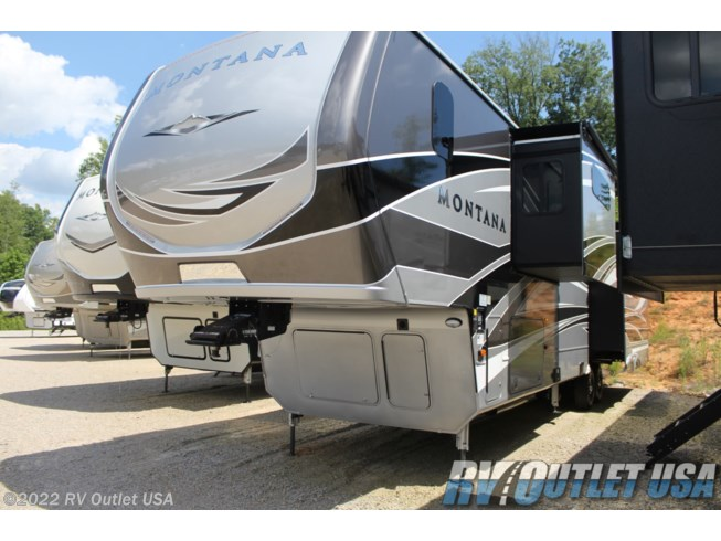 2020 Keystone Montana Legacy 3931FB - New Fifth Wheel For Sale by RV Outlet USA in Ringgold, Virginia features 50 Amp Service, Air Conditioning, Alloy Wheels, AM/FM/CD, Automatic Leveling Jacks, Auxiliary Battery, Backup Camera, Backup Monitor, Bath & 1/2, Battery Charger, Black Tank Flush, Cable Prepped, Ceiling Fan, Central Vacuum, CO Detector, Convection Microwave, Converter, Day/Night Shades, Detachable Power Cord, DVD Player, Enclosed Underbelly, Enclosed Water Tank, Exterior Speakers, External Shower, Fire Extinguisher, Fireplace, Free Standing Dinette w/Chairs, Full Body Paint, Furnace, Glass Shower Door, Heated Underbelly, Heated Water Tank, Hide-A-Bed, Hitch, Inverter, Island Kitchen, King Size Bed, Ladder, LED HDTV, LED Lights, Load Lights, LP Detector, Medicine Cabinet, Mor-Ryde Pin Box, Mor-Ryde Suspension, Outside Entertainment Center, Oven, Overhead Cabinetry, Pantry, Pass Thru Storage, Power Awning, Power Roof Vent, Powered Landing Legs, Propane, Recliner(s), Residential Refrigerator, Roof Vent, Roof Vents, Screen Door, Second Roof A/C, Shower, Skylight, Slam Latch Baggage Doors, Slideout, Smoke Detector, Solar Prep, Solid Surface Countertops, Spare Tire Kit, Stainless Appliances, Stove Top Burner, Surround Sound System, Theater Seating, Tinted Windows, TV, TV Antenna, Upgraded Insulation Package, Washer/Dryer Prep, Water Heater