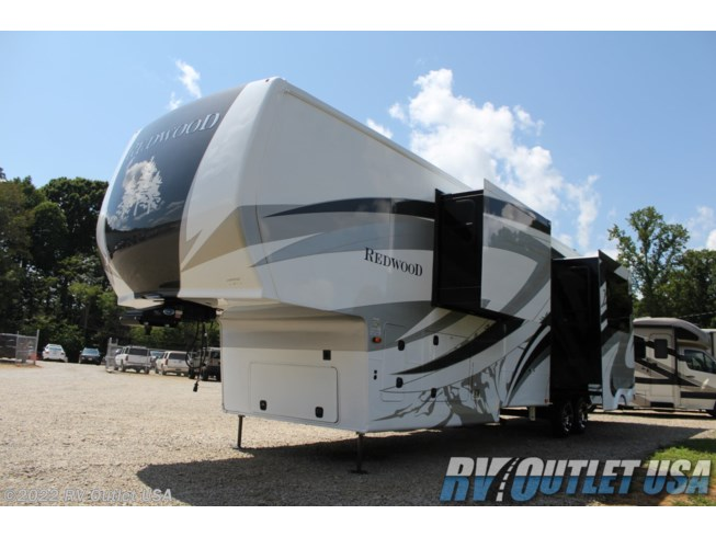 2021 Redwood RV 4001LK - New Fifth Wheel For Sale by RV Outlet USA in Ringgold, Virginia features 50 Amp Service, Air Conditioning, Alloy Wheels, Aluminum Entrance Steps, AM/FM/CD, Automatic Leveling Jacks, Auxiliary Battery, Bath & 1/2, Battery Charger, Black Tank Flush, Bluetooth Stereo, Cable Prepped, CD Player, Ceiling Fan, Central Vacuum, CO Detector, Convection Microwave, Converter, Detachable Hitch, Detachable Power Cord, DVD Player, Enclosed Underbelly, Enclosed Water Tank, Exterior Speakers, External Shower, Fantastic Fan, Fireplace, Free Standing Dinette w/Chairs, Full Body Paint, Furnace, Heated Underbelly, Heated Water Tank, Icemaker, Inverter, Ladder, LED HDTV, LED Lights, Load Lights, LP Detector, Mor-Ryde Pin Box, Mor-Ryde Suspension, Outside Entertainment Center, Oven, Pass Thru Storage, Power Awning, Power Roof Vent, Powered Landing Legs, Propane, Refrigerator, Residential Refrigerator, Roof Vent, Satellite Prepped, Screen Door, Second Roof A/C, Skylight, Slideout, Smoke Detector, Solar Prep, Sound Bar, Spare Tire Kit, Stainless Appliances, Stove Top Burner, Surround Sound System, Thermal Pane Windows, Tinted Windows, TV, TV Antenna, Upgraded Insulation Package, Water Heater