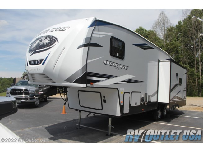 2021 Forest River Cherokee Arctic Wolf 291RL - New Fifth Wheel For Sale by RV Outlet USA in Ringgold, Virginia features 50 Amp Service, Air Conditioning, Alloy Wheels, Aluminum Entrance Steps, Automatic Leveling Jacks, Battery Charger, Black Tank Flush, Cable Prepped, CD Player, CO Detector, Converter, Detachable Power Cord, Enclosed Underbelly, Enclosed Water Tank, Exterior Speakers, External Shower, Fireplace, Free Standing Dinette w/Chairs, Furnace, Heated Underbelly, Heated Water Tank, Hide-A-Bed, Island Kitchen, LED Lights, Load Lights, LP Detector, Medicine Cabinet, Microwave, Oven, Overhead Cabinetry, Pantry, Pass Thru Storage, Power Awning, Powered Landing Legs, Propane, Queen Bed, Queen Mattress, Refrigerator, Roof Vent, Screen Door, Shower, Slideout, Smoke Detector, Solid Surface Countertops, Spare Tire Kit, Stainless Appliances, Stereo System, Stove, Stove Top Burner, Tinted Windows, TV Antenna, Upgraded Insulation Package, Wardrobe(s), Water Heater