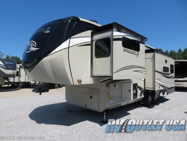 2021 Jayco Pinnacle 32RLTS - New Fifth Wheel For Sale by RV Outlet USA in Ringgold, Virginia features 50 Amp Service, Air Conditioning, Alloy Wheels, Aluminum Entrance Steps, Automatic Leveling Jacks, Battery Charger, Black Tank Flush, Cable Prepped, CD Player, CO Detector, Converter, Detachable Power Cord, Enclosed Underbelly, Enclosed Water Tank, Exterior Speakers, External Shower, Fantastic Fan, Fiberglass Sidewalls, Fire Extinguisher, Fireplace, Free Standing Dinette w/Chairs, Furnace, Glass Shower Door, Heated Underbelly, Heated Water Tank, Hide-A-Bed, Inverter, Island Kitchen, King Size Bed, Ladder, LED HDTV, LED Lights, Load Lights, LP Detector, Medicine Cabinet, Microwave, Mor-Ryde Pin Box, Oven, Overhead Cabinetry, Pantry, Pass Thru Storage, Power Awning, Power Roof Vent, Powered Landing Legs, Propane, Recliner(s), Residential Refrigerator, Roof Vent, Roof Vents, Satellite Prepped, Second Roof A/C, Shower, Skylight, Smoke Detector, Solid Surface Countertops, Spare Tire Kit, Stainless Appliances, Stove Top Burner, Theater Seating, Tinted Windows, TV, TV Antenna, Washer/Dryer Prep, Water Heater