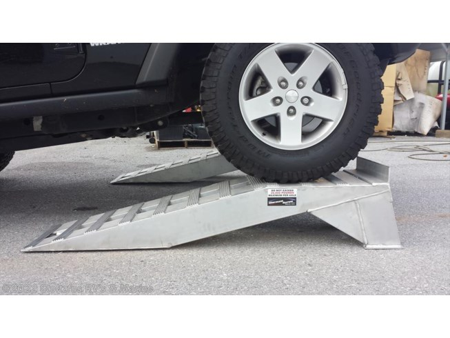 Brand new Aluminum ramps. 100$/Each, Max capacity is 20,000lbs