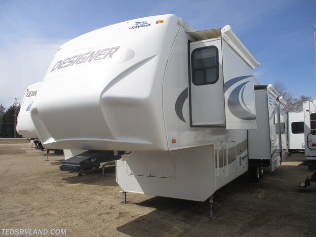 2009 Jayco Designer 34 RLQS - Used Fifth Wheel For Sale by Ted's RV Land in  Paynesville, Minnesota features Air Conditioning, Auxiliary Battery, Awning, CD Player, Ceiling Fan, Central Vacuum, CO Detector, DVD Player, External Shower, Free Standing Dinette w/Chairs, Ladder, Leveling Jacks, LP Detector, Medicine Cabinet, Microwave, Oven, Queen Bed, Refrigerator, Rocker Recliner(s), Roof Vents, Shower, Skylight, Slideout, Smoke Detector, Spare Tire Kit, Stove Top Burner, Surround Sound System, Toilet, TV, Water Heater