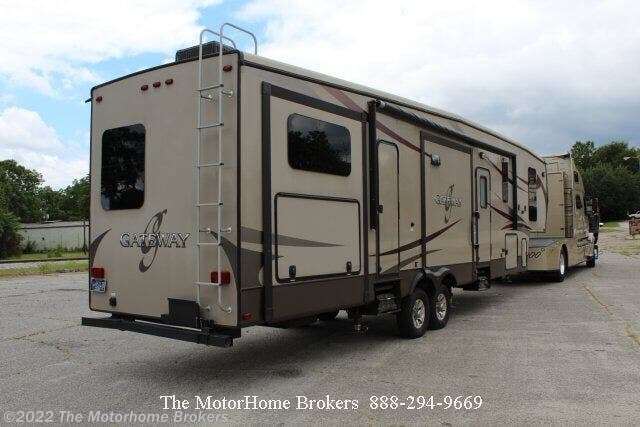 2016 Heartland Gateway 3650BH (SOLD) - Used Fifth Wheel For Sale by The Motorhome Brokers in Salisbury, Maryland features 50 Amp Service, Air Conditioning, Auxiliary Battery, Azdel Composite Panels, Bath & 1/2, Battery Charger, Black Tank Flush, Bunk Beds, Bunkhouse, Cable Prepped, CD Player, CO Detector, Converter, Enclosed Water Tank, Exterior Refrigerator, Exterior Speakers, External Shower, Fantastic Fan, Fire Extinguisher, Full Body Paint, Furnace, Glass Shower Door, King Size Bed, Kitchen Sink, Ladder, Leather Furniture, LED HDTV, LED Lights, Leveling Jacks, LP Detector, Medicine Cabinet, Microwave, Non-Smoking Unit, Outside Entertainment Center, Outside Kitchen, Oven, Overhead Cabinetry, Pantry, Pass Thru Storage, Power Awning, Power Roof Vent, Propane, Refrigerator, Residential Refrigerator, Roof Vents, Screen Door, Second Roof A/C, Self Contained, Shower, Skylight, Slideout, Smoke Detector, Sofa Bed, Solid Surface Countertops, Spare Tire Kit, Stabilizer Jacks, Stainless Appliances, Stove, Surround Sound System, Thermal Pane Windows, Tinted Windows, Toilet, TV, TV Antenna, U-Shaped Dinette, Vanity, Wardrobe(s), Washer/Dryer Prep, Water Heater