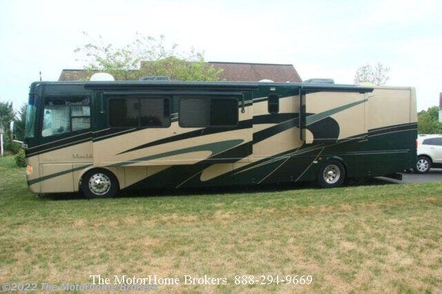 2004 Thor Motor Coach Mandalay 40D (SOLD) - Used Diesel Pusher For Sale by The Motorhome Brokers in Salisbury, Maryland features 50 Amp Service, 6-Way Power Driver's Seat, Air Assist Suspension, Air Conditioning, AM/FM/CD, Automatic Leveling Jacks, Backup Camera, Backup Monitor, Bath & 1/2, Batteries, Battery Charger, Cable Prepped, Central Vacuum, Convection Microwave, Converter, DVD Player, Enclosed Water Tank, Fantastic Fan, Fire Extinguisher, Free Standing Dinette w/Chairs, Front Overhead Storage, Full Body Paint, Furnace, Generator, Glass Shower Door, Hide-A-Bed, Hitch, Inverter, Kitchen Sink, Ladder, LCD HDTV, Leather Furniture, LP Detector, Medicine Cabinet, Non-Smoking Unit, Overhead Cabinetry, Pass Thru Storage, Power Awning, Power Entrance Step, Power Roof Vent, Propane, PVC Roof, Queen Bed, Refrigerator, Roof Vents, Satellite Dish, Second Roof A/C, Self Contained, Shower, Slideout, Slide-out Awning, Smoke Detector, Solid Surface Countertops, Stainless Appliances, Stove Cover, Stove Top Burner, Surround Sound System, Toilet, TV Antenna, Wardrobe(s), Water Heater